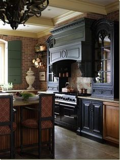 I adore interior brick walls, so I was immediately smitten with this French Country Kitchen by designers, Sally Wilson and John Kelsey of Wilson Kelsey Design.