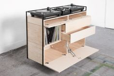 For your fellow DJ vinyl collector or the Selectors Cabinet by will surpass your aesthetic and functionality expectations. Made with a steel frame and wooden cabinets it will house your equipment vinyls and CD collection. by designmilkeveryday Interior Design Studio, Interior Styling, Cool Furniture, Furniture Design, Dj Stand, Dj Table, Vynil, Dj Setup, Vinyl Record Storage