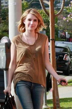 Emma Roberts wears COURAGE giving key in antique copper