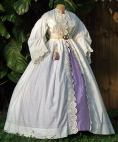 Maternity dress with machine embroidery c.1858-1863. Shown with original accessories