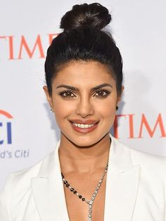 Spring Beauty Looks - Priyanka Chopra Topknot + Flawless Face   allure.com