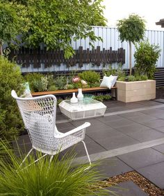 Courtyard Ideas- large pavers make it appear a larger space