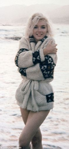 Pictured on Santa Monica beach in July 1962, she must have loved water, so many pictures of her in water.