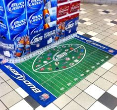 Bud Light does it right.  They not only use a floor graphic to draw attention, but make it interactive and relevant by tying in football.