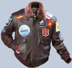 The G-1 Navy Top Gun flight jacket as seen in the movie. This is a faithful reproduction of Maverick's jacket, including all of the patches. It is the G-1 goatskin in seal brown with a medium brown mouton collar. It is available with single entry pockets (military spec) or with hand warmer pockets (no extra charge). Explore the collection of our military spec. flight jackets at a discounted price. Made IN THE USA www.flightJacket.com