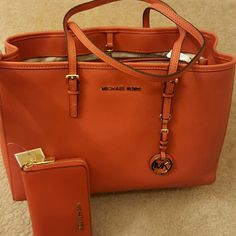 Michael kors Tote!!!! Brand New! 100%AUTHENTIC!!!! Gorgeous  Michael kors Burnt Orange Tote!!!! Never used and in perfect condition! A bargain!!!! Dimensions are 14 inches W, 10 inches  H and 6 inches D.   A gorgeous color!!!!!! Michael Kors Bags Totes