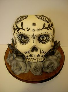 Day of the dead sugar skull tattoo cake by fairycakes and faces, via Flickr