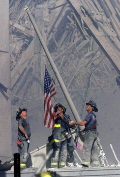 Fire Fighters Raising the Flag At Ground Zero