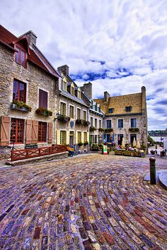 Place Royale, in lower old town, Quebec City. A great place to sit at an outdoor cafe and people watch or listen to street performers. Old Quebec, Montreal Quebec, Quebec City, Visit Canada, O Canada, Canada Travel, Canada Trip, Ottawa, Oh The Places You'll Go
