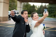 The bride and groom pause for a quick cell phone picture before the reception. Ok, I asked them to pose, but it's still funny!    S Rain Photography - Minneapolis St Paul wedding photographer