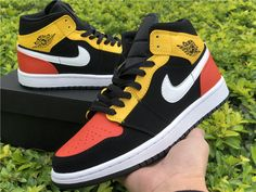 This mid-top Air Jordan 1 features a Black nubuck base with Orange leather on the toe and heel, while Yellow leather covers the ankle area and eyestay. Retro Jordans 11, Jordans Girls, Nike Air Jordans, Nike Air Max, Nike Basketball Shoes, Jordan 1 Mid, Jordan Retro, Kicks Shoes, Shoes