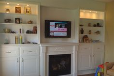 TV mounted over fireplace. Cables fished through the wall, down to the basement & fished back up to the main floor ending up coming out of the wall inside the cabinet. IR repeater is installed in order to control components hidden inside the cabinet. Best Tv Wall Mount, Tv Wall Mount Bracket, Wall Mounted Tv, Tv Wall Mount Installation, Home Theater Installation, Tv Mount Over Fireplace, Fireplace Surrounds, Separating Rooms, Concrete Slab