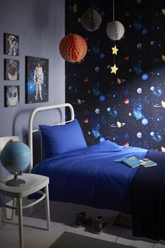 Cosmos - An amazing realistic space effect depicting the fabulous solar system. Creating a fantastic 3D effect on any wall this design will take you to outer space!