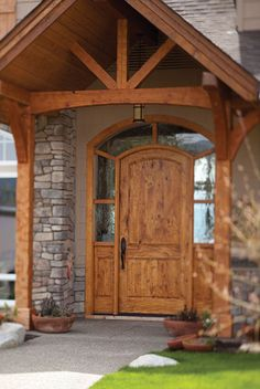 Flat arch sidelight and toplight entrance door is an excellent light stain more common for casual environments but it works because of the high ceiling portico and columns.