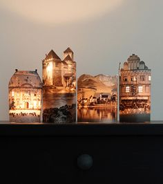 Paper lanterns by Claire of fellowfellow. The candle's glow brings warmth and life to cleverly cut-up photographs. You can find the full tutorial here http://fellowfellow.com/diy-houses-by-night/