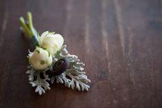 Boutonniere with ivory ranunculus, uhule fern curl and dusty miller. Flowers by Cincinnati wedding florist Floral Verde LLC.