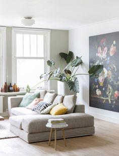Binnenkijken in drie verdiepingen appartement in Amsterdam West - rustige-zithoek-schilderij