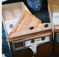 Since the bride and groom are both writers, they carried their literary theme over to the escort cards, which resembled an old library card catalog. Each guest's name was printed in typewriter font, along with a quote that complemented their personality.