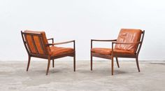 Ib Kofod Larsen Lounge Chairs | From a unique collection of antique and modern lounge chairs at http://www.1stdibs.com/furniture/seating/lounge-chairs/