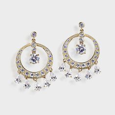 High quality cubic zirconia drop earrings feature brilliant round and pear shape stones in a chandelier style. An approximate 4.40 total carat weight. These cubic zirconia earrings are 1 1/8 inches long and 3/4th of an inch wide. Available in 14k white gold or 14k yellow gold. Cubic zirconia weights refer to equivalent diamond carat size.
