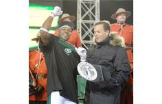Saskatchewan Roughriders running back Kory Sheets (#1) wins MVP, the award presented by CFL commissioner Mark Cohon at the end of the 101st ...
