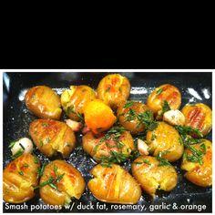 Jaime Oliver Smash Potato recipe with duck fat, garlic, rosemary, cider vinegar, olive oil, orange peel and salt/pepper. Delicious.