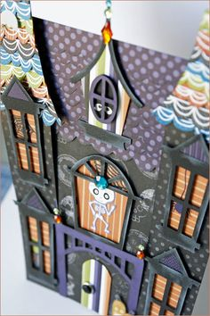 Haunted house paper template. Could use this idea for Visions of Sugar Plums party.  Just change the colors and window decorations.