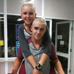 Adorable couple! She has cancer, so he shaved his head to show her how much he cares. (Notice their matching outfits)