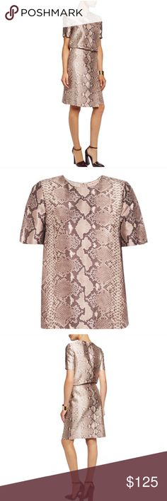 NWT Tory Butch Mikado Python Print Top Tory Burch snake-print top. An always chic print to wear now or later. This silk wooo Mikado top is a refined T-shirt silhouette that's streamlined and clean-edged, with a easy, straight fit. In soft neutral tones, it taps into the mod inspiration of the season while bringing an exotic accent to both casual and dressy looks Silk and wool-blend  Fully lined Concealed zip fastening along back 56% silk, 44% wool.  Retail price: $395  Size 2 Tory Burch Tops