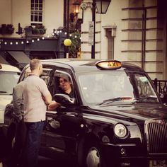 London Taxi driver talking to potential customer. Street Photography by Mike Resch