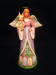 Item Description: Pretty in pastel, this angel from Jim Shore's Heartwood Creek collection is (we believe) now retired.
