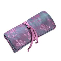 """Large Jewelry Roll-Silk Jacquard-Orchid-Womens.  Product Content: Silk/Rayon Blend w/Satin Lining.  Inside Sections: 1 roll carrier for rings, 3 zippered pockets, and 1 large open compartment.  Tie close  Measures 8"""" Length x 4"""" Width; opens to 11"""" Length.  Imported. Dry Clean if neede..."""