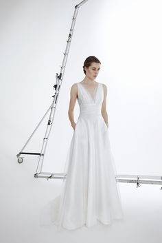 Style GIOIA: Flared V neck gown in silk mikado with draped tulle