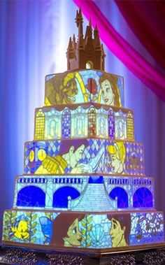 Amazing images are programmed and digitally projected onto a five-tier wedding cake, bringing your wedding reception (and dessert) to life! #weddingcakes