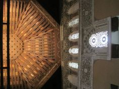 Museo Sefardi, Toledo.  View of wooden ceiling and wall with fabric, carving and light coming through