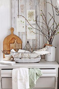 I adore the prints displayed so causally on the rustic wood planks.  via VIBEKE DESIGN: Fortsatt favoritt!