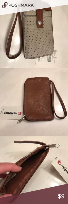 Wristlet Ladies wristlet from the Buckle NWT Camel brown and tannish grey color-measures 6 1/4inches by 3 3/4inches Buckle Bags Clutches & Wristlets