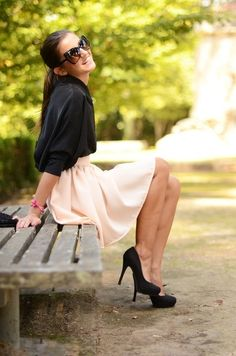 Cute creme skirt with black blouse and heels combo