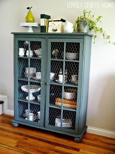 I really like the wall color with the blue hutch. I have that ancient buffet table that Ive been looking to refurbish...