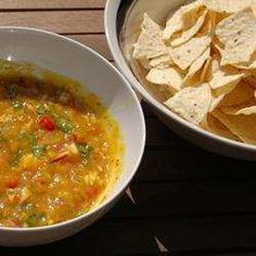 Hot, spicy, and sweet - this mango salsa made with fresh cilantro and habanero peppers is great with fish or chops, or just with chips. Salsa Picante, Spicy Salsa, Mango Salsa, Salsa Verde, Mexican Kitchens, Mexican Dishes, Mexican Food Recipes, Ethnic Recipes, Mexico Food