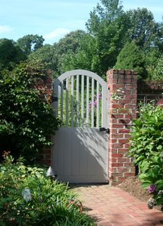 Painted Wood Garden Gate With Brick Wall Traditional Landscape