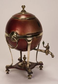 """Antique Hot Air Balloon Samovar c. 1790 A samovar; literally """"self-boiler"""", is a heated metal container traditionally used to heat and boil water. Since the heated water is typically used to make tea, many samovars have a ring-shaped attachment around the chimney to hold and and heat a teapot filled with tea concentrate"""