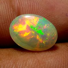 3.2 Carat 13.8x10 MM Natural AAA Multi Fire Ethiopian Opal Oval Shape Cabochon #Unbranded