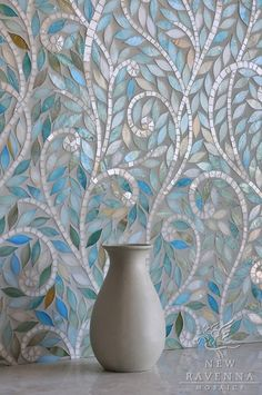 BEAUTIFUL backsplash.  Go to www.newravenna.com and search on Jacqueline.  So many beautiful patterns for tiles, backsplash, floors, wallpaper, etc.    Leaves and Vines in glass Quartz and Aquamarine.