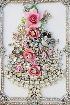 I have tons of old jewelry which would be awesome to assemble like this in a frame....but now I am thinking of decorating a mirror with it!