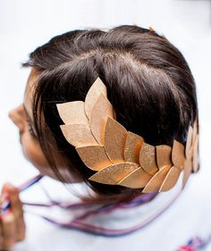 Modeled after the traditional wreaths from the original Games in Ancient Greece, you can make these glittery versions for your guests to wear during the party. All you need is cardstock, thick wire, and gold spray paint to put it all together.