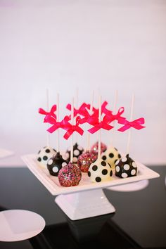 Colorful glitter cake pops with black & white polka dots! Add a pink bow! Super cute idea for modern dessert table!