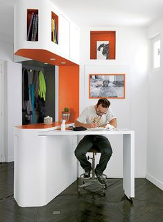 An incredible small space solution with a table that rolls out from the wall.