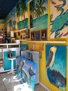 Artist Kathy Frosio's bright, bold paintings on wood are a popular draw and our best-sellers!<br /> <br /> Coastal, locally-made decor is our specialty but don't worry if your home has a different motif. We have jewelry, candles, pottery, cards, whimsical prints and much more -- perfect gifts for your family, friends, pet sitter and for your holiday list! (Photo by Aimee K. Wiles-Banion)