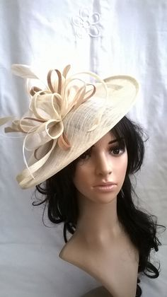 Ivory Fascinator Hat With Gold Trim Feathers On A Headband